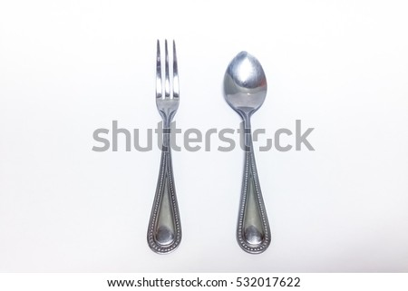 small stainless fork and spoon isolated on the white background