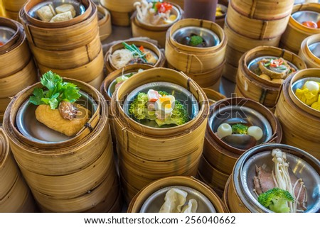 Small steamer baskets of Dim Sum in restaurant - stock photo