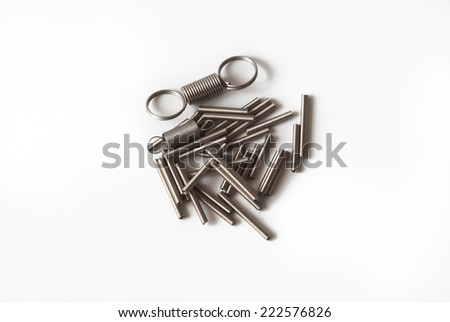 Small steel springs on white background