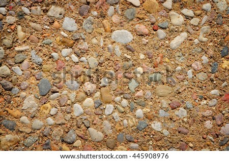 small stones in solid soil - stock photo