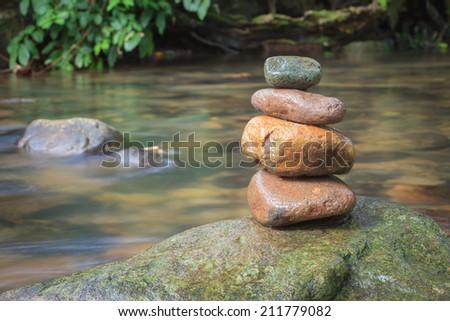 small stones pyramid in nature - stock photo