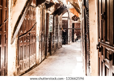 Small street in Fez medina (old town). Morocco. - stock photo