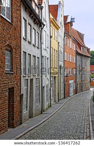 Small street with old buildings in Lubeck, Germany - stock photo