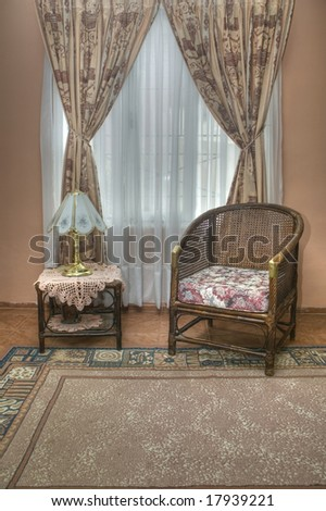Small table and wicker sofa - stock photo