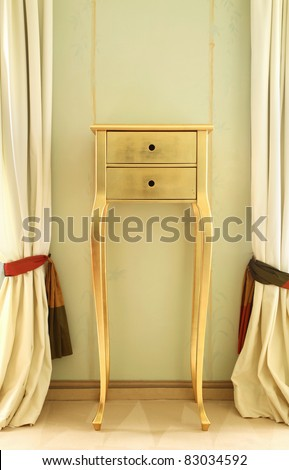 small table between the curtains of beautiful suites - stock photo