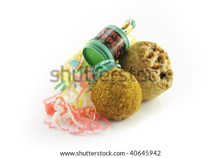 Small tasty pork pie, small round scotch egg and streamers with party popper on a reflective white background - stock photo