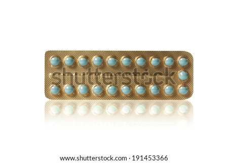 small teal pills in a blister - stock photo
