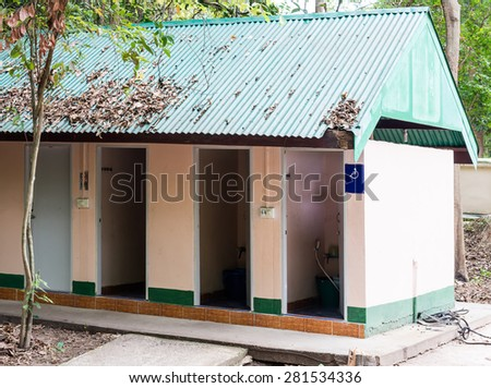 Small toilet near the forest in Thai temple. - stock photo