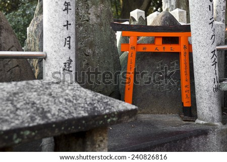 Small tori gates at Fushimi Inari Shrine in Kyoto, Japan - stock photo