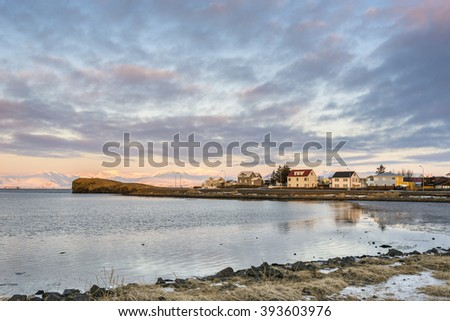 Small town Hofn at sunrise in winter. Iceland. - stock photo