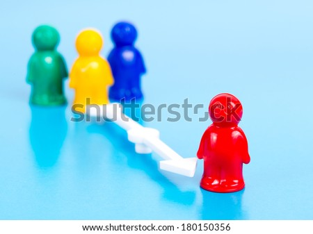 small toy people and arrow - stock photo
