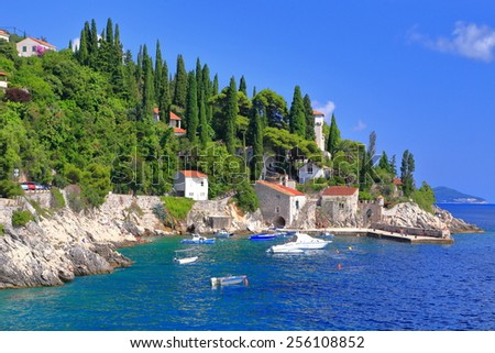 Small traditional harbor on the Adriatic sea coast, Trsteno, Croatia - stock photo