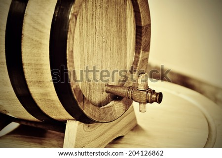 Small traditional oak household wine cask with wooden tap - stock photo