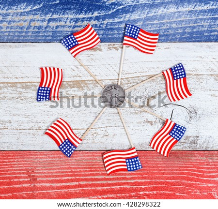 Small Usa Flags Forming Circle Around American Liberty Dollar Coin On Red White And Blue