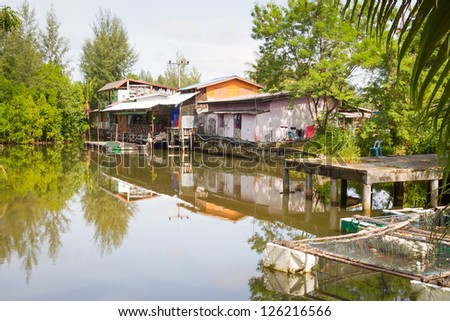 Small village house at the water in Thailand