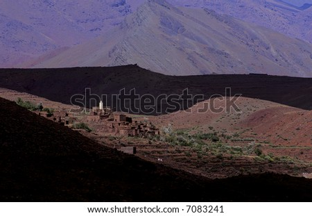 Small village in the hills of the Atlas mountains in Morocco - stock photo