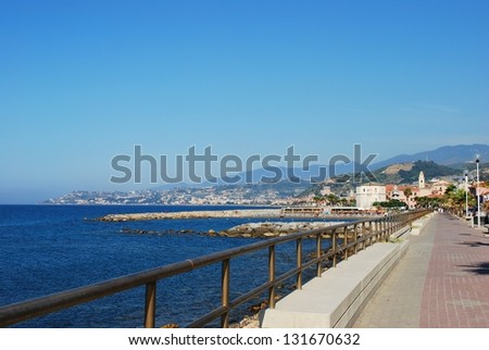 Small village on Mediterranean sea in summer, Santo Stefano al Mare, Liguria, Italy - stock photo