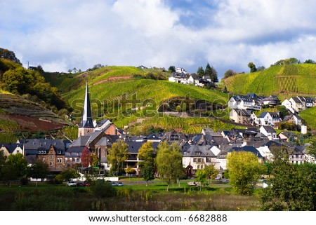 small village, vineyards and forest along the mosel river in germany - stock photo