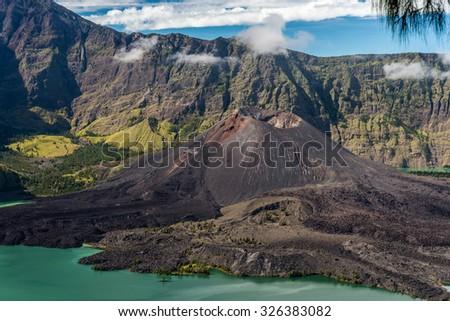 Small volcano in lagoon of Mt.Rinjani, Indonesia - stock photo