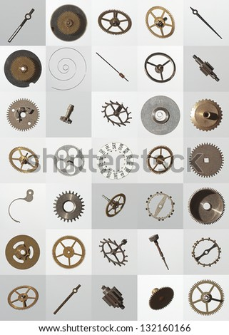small watch cogs and other parts, looking down from above background - stock photo