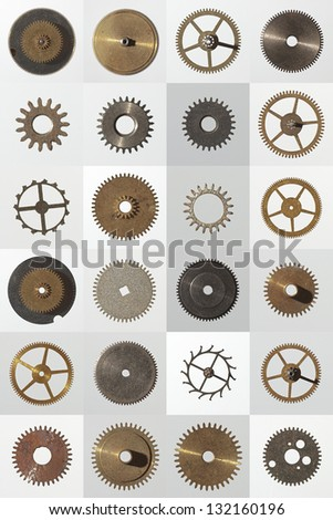 small watch cogs looking down from above background - stock photo