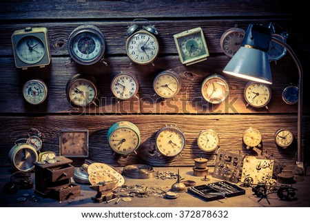 Small watchmaker's workshop full of clocks - stock photo