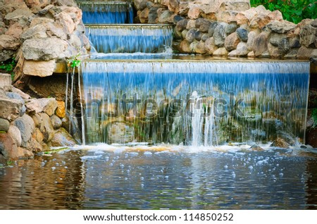 Small Water Cascade In The City Park - stock photo