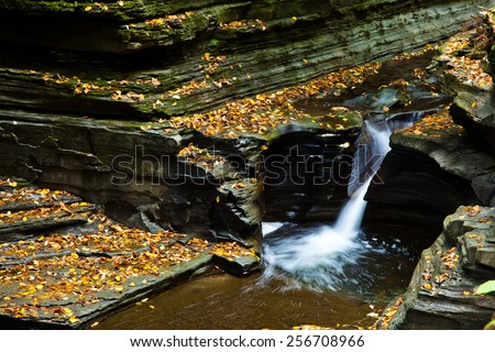 Small waterfall and pool in autumn  - stock photo