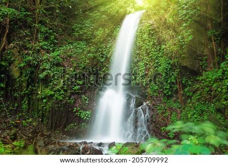 Small waterfall in jungle near Lake Maninjau in West Sumatra, Indonesia - stock photo
