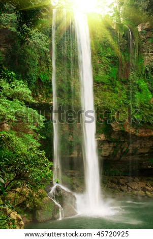 Small waterfall in jungles with sun