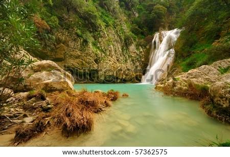 Small waterfall in Polilimnio, Greece - stock photo