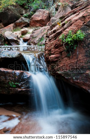 Small Waterfall next to a Bolder - stock photo