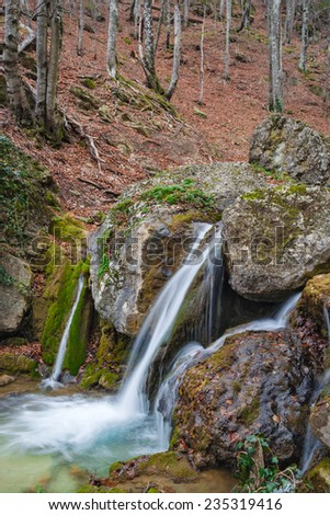 small waterfall on the forest river - stock photo