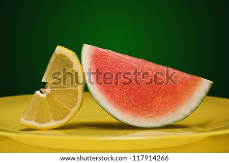 Small watermelon with lemon on the plate