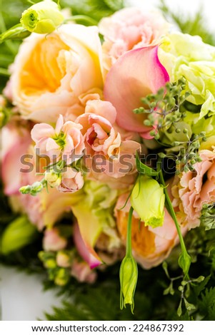 Small wedding bouquet with roses on a white background.