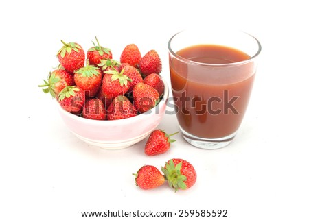 Small white bowl filled with succulent juicy fresh ripe red strawberries isolated on white - stock photo