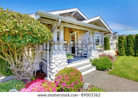 Small white cottage house from exterior.