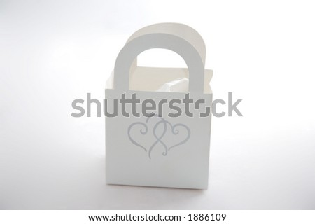 Small white party favor, suitable for a wedding or bridal shower.