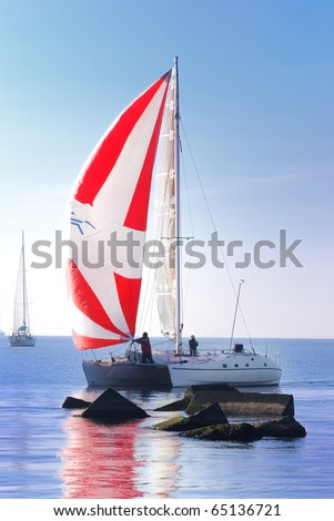 small white yacht sailing in sunny day - stock photo
