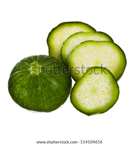 small whole round zucchini  and a number of sliced  circles isolated on white background - stock photo