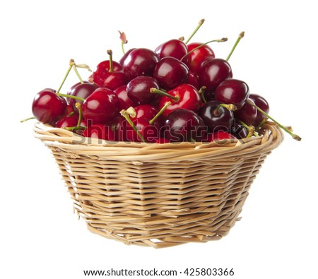 Small wicker basket full of cherries on white background