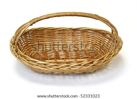 Small wicker basket over the white background - stock photo