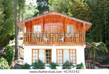 Small wood cabin on a hill top - stock photo