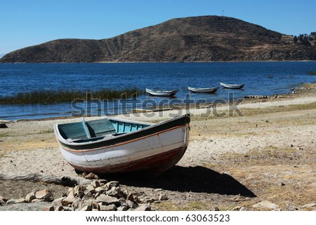 small wooden boat on lake titicaca - stock photo
