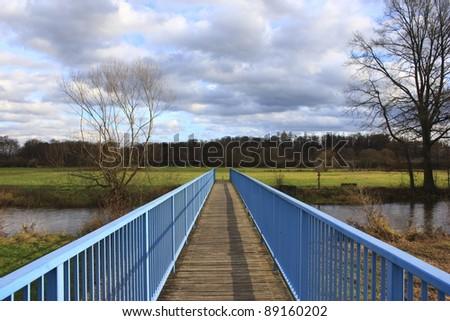 Small wooden bridge - stock photo