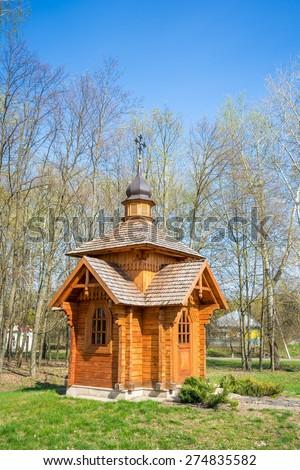 Small wooden chapel near the pass. Baturin, Ukraine. - stock photo