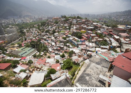 Small wooden coloured houses in the poor neighborhood in Caracas. It cover the hills around Caracas and it is dangerous at all times. - stock photo