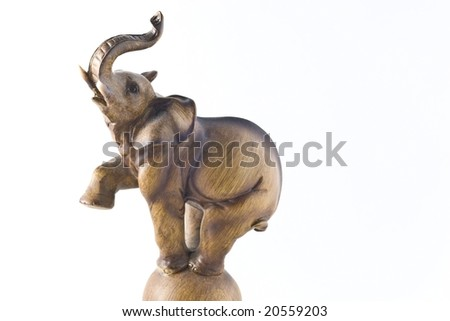 Small wooden elephant statuette on white background