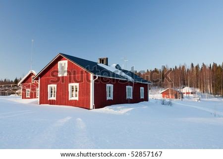Small wooden houses in winter. Finland. - stock photo