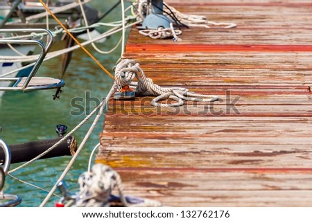 Small wooden pier at the sailing club - stock photo